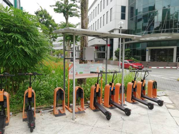 Singapore-based Electric Scooter Startup Neuron Wows CES solar powered charging modular docking stations